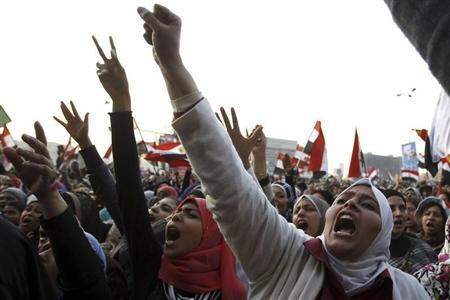 Women shout during a protest in Tahrir Square in Cairo January 25, 2013. REUTERS/Mohamed Abd El Ghany