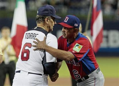 U.S. manager Joe Torre (L) shakes hands with Dominican Republic manager Tony Pena before their teams met during a 2013 World Baseball Classic game in Miami, Florida March 14, 2013. REUTERS/Joe Skipper
