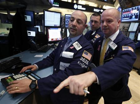Traders work on the floor at the New York Stock Exchange, March 14, 2013. REUTERS/Brendan McDermid