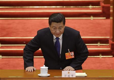 China's newly-elected President Xi Jinping takes a seat before the fifth plenary meeting of the National People's Congress (NPC) at the Great Hall of the People in Beijing, March 15, 2013. REUTERS/Jason Lee