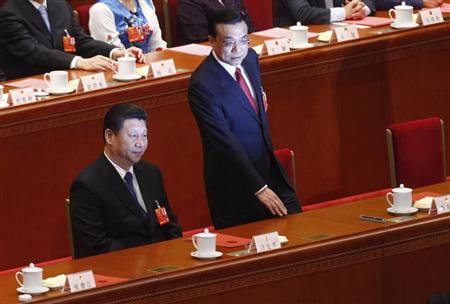 China's President Xi Jinping and China's newly-elected Premier Li Keqiang are being photographed during the fifth plenary meeting of the National People's Congress (NPC) at the Great Hall of the People in Beijing, March 15, 2013. REUTERS/Barry Huang