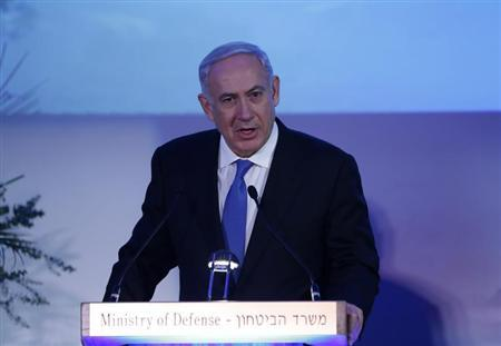 Israel's Prime Minister Benjamin Netanyahu speaks during a farewell event for outgoing Defence Minister Ehud Barak at Bar-Ilan University near Tel Aviv March 13, 2013. REUTER/Baz Ratner