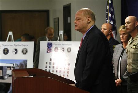 Arizona Attorney General Tom Horne speaks about weapons and drugs seized from the Mexican Sinaloa cartel during ''Operation Pipeline Express'' at a news conference in Phoenix, Arizona October 31, 2011. REUTERS/Joshua Lott
