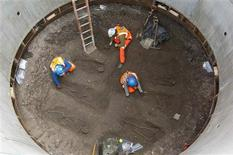 "Archaeologists work on unearthed skeletons in the Farringdon area of London in this undated handout photograph released March 15, 2013. Archaeologists said on Friday they had found a graveyard during excavations for a rail project in London which might hold the remains of some 50,000 people killed by the ""Black Death"" plague more than 650 years ago. Thirteen skeletons laid out in two neat rows were discovered 2.5 metres (8 feet) below the road in the Farringdon area of central London by researchers working on the 16 billion pound ($24 billion) Crossrail project. REUTERS/Crossrail/Handout"