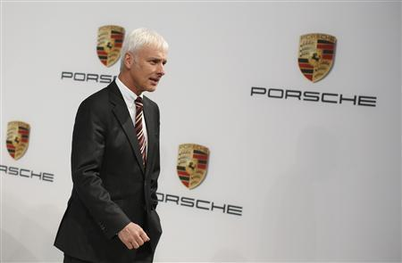 Matthias Mueller, Chief Executive Officer of German sports car manufacturer Porsche arrives for the annual news conference at the Porsche headquarters in Stuttgart March 15, 2013. REUTERS/Lisi Niesner