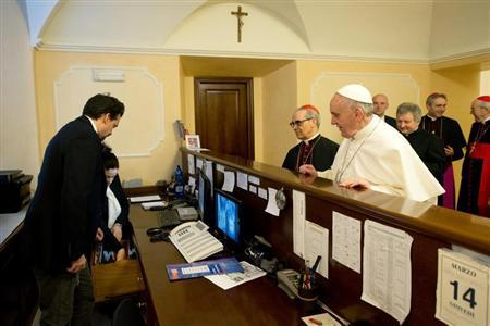 Newly elected Pope Francis I, Cardinal Jorge Mario Bergoglio of Argentina, checks out of the church-run residence March 14, 2013 where he had been staying in Rome, in a picture released by Osservatore Romano March 15, 2013. REUTERS/Osservatore Romano
