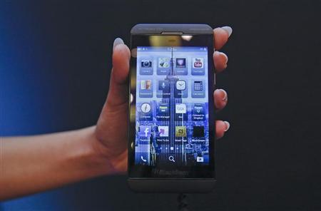 A BlackBerry salesperson displays a BlackBerry Z10 during the launch of the BlackBerry 10 smartphone in Mumbai February 25, 2013. REUTERS/Vivek Prakash
