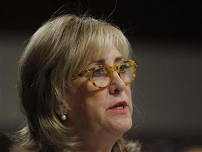 Ina Drew, former Chief Investment Officer of JP Morgan Chase Bank, testifies before the Senate Homeland Security Investigations Subcommittee in Washington March 15, 2013. The Committee is investigating the JPMorgan Chase Whale Trades. REUTERS/Gary Cameron