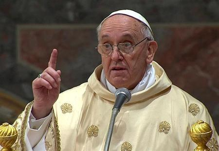 Newly elected Pope Francis I, Cardinal Jorge Mario Bergoglio of Argentina, leads a a mass with cardinals at the Sistine Chapel, in a still image taken from video at the Vatican March 14, 2013. REUTERS/Vatican CTV via Reuters TV