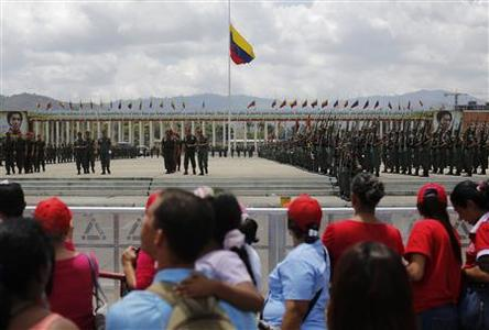 Military cadets practise a drill for Friday's parade to honour Venezuela's late President Hugo Chavez, at the military academy in Caracas March 14, 2013. REUTERS/Tomas Bravo