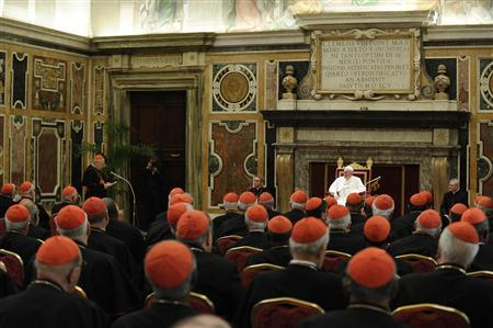 Newly elected Pope Francis I, Cardinal Jorge Mario Bergoglio of Argentina, meets cardinals in the Clementine Hall in a picture released by Osservatore Romano at the Vatican March 15, 2013. REUTERS/Osservatore Romano