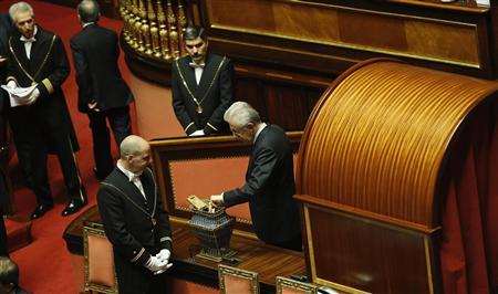 Italy's outgoing Prime Minister Mario Monti votes during a debate at the Senate in Rome March 15, 2013. REUTERS/Remo Casilli