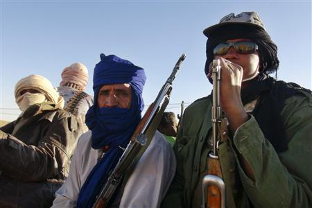 Soldiers from the Tuareg rebel group MNLA sit in a pickup truck in the northeastern town of Kidal February 4, 2013. REUTERS/Cheick Diouara