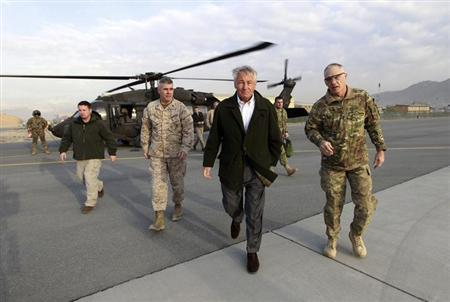 U.S. Secretary of Defense Chuck Hagel walks from a blackhawk helicopter to his military transport aircraft in Kabul, March 11, 2013, as he returns to Washington. REUTERS/Jason Reed