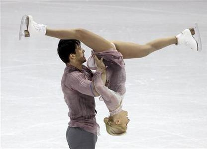 Tatiana Volosozhar (R) and Maxim Trankov of Russia perform their free skating program at the ISU World Figure Skating Championships in London, March 15, 2013. REUTERS/Fred Thornhill