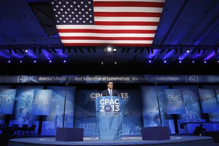 Former U.S. presidential candidate Mitt Romney stands onstage for remarks to the Conservative Political Action Conference (CPAC) in National Harbor, Maryland, March 15, 2013. REUTERS/Jonathan Ernst