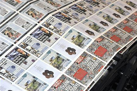 Copies of the final edition of the News of the World are printed on the presses at the News International print works in Waltham Cross, southern England July 9, 2011. REUTERS/Ian Nicholson/Pool