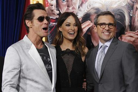 Cast members Jim Carrey (L), Olivia Wilde and Steve Carell pose at the premiere of ''The Incredible Burt Wonderstone'' in Hollywood, California March 11, 2013. REUTERS/Mario Anzuoni