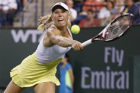 Caroline Wozniacki of Denmark returns a shot against Angelique Kerber of Germany during their women's singles semifinal match at the BNP Paribas Open WTA tennis tournament in Indian Wells, California, March 15, 2013. REUTERS/Danny Moloshok