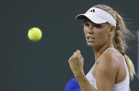 Caroline Wozniacki of Denmark celebrates winning a point against Angelique Kerber of Germany during their women's singles semifinal match at the BNP Paribas Open WTA tennis tournament in Indian Wells, California, March 15, 2013. REUTERS/Danny Moloshok