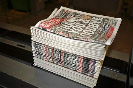 Copies of the final edition of the News of the World roll off the presses at the News International print works in Waltham Cross, southern England July 9, 2011. REUTERS/Ian Nicholson/Pool