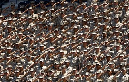 United States Marines salute from the stands during the American National Anthem prior to the start of the San Diego Padres vs the New York Mets baseball Major League Baseball game in San Diego, California August 9, 2009. REUTERS/Mike Blake