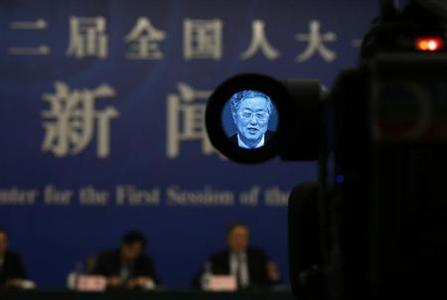 A television camera screen shows China's central bank governor Zhou Xiaochuan answering a question at a news conference during China's annual session of parliament, in Beijing March 13, 2013. REUTERS/Jason Lee