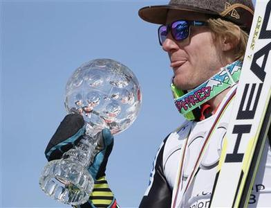 Ted Ligety of the U.S. shows the men's Giant-Slalom trophy following the season's last race at the Alpine Skiing World Cup finals in Lenzerheide March 16, 2013. REUTERS/Denis Balibouse