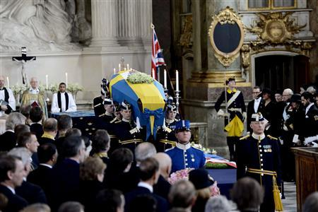 Members of the Royal Guard carry the coffin of Sweden's British-born Princess Lilian from the Royal Chapel of the Royal Palace of Stockholm, March 16, 2013, after her funeral service. REUTERS/Maja Suslin/Scanpix
