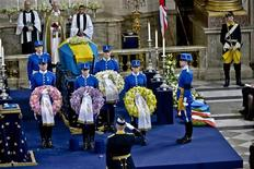 Members of the Royal Guard hold wreaths in front of the coffin of Sweden's British-born Princess Lilian after her funeral service in the Royal Chapel of the Royal Palace of Stockholm, March 16. REUTERS/Jonas Ekstromer/Scanpix