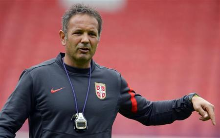 Serbia's national soccer team coach Sinisa Mihajlovic conducts a training session at Hampden Park Stadium in Glasgow, Scotland September 7, 2012. REUTERS/Russell Cheyne/Files