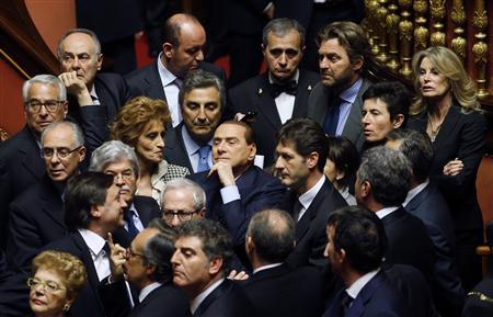 Italy's former prime minister Silvio Berlusconi (C) looks on during the vote at the Senate in Rome March 16, 2013. REUTERS/Remo Casilli