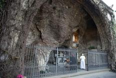 Pope Francis I prays before the replica of the Grotto of Lourdes at the Vatican Gardens in the Vatican March 16, 2013. REUTERS/Osservatore Romano