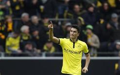 Nuri Sahin do Borussia Dortmund comemora gol contra o Freiburg durante campeonato alemão, em Dortmund. 16/03/2013 REUTERS/Ina Fassbender