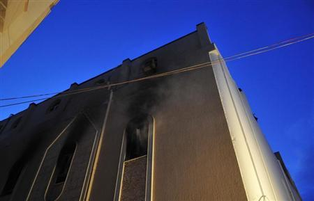 An Egyptian Coptic Church that was set on fire is seen in Benghazi March 14, 2013. REUTERS/Esam Al-Fetori
