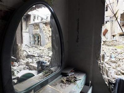 An old damaged house is pictured in Homs March 16, 2013. REUTERS/Yazen Homsy