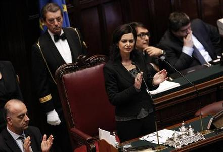 Laura Boldrini from the centre-left claps after the vote electing her as the new lower house president at the Chamber of Deputies in Rome March 16, 2013. REUTERS/Ciro De Luca