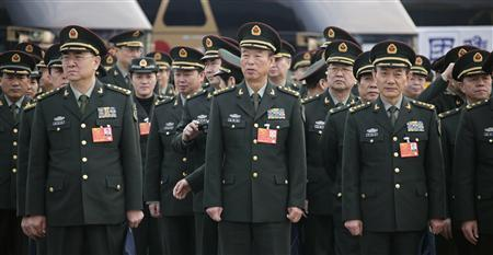 Military delegates stand in lines outside the Great Hall of the People, ahead of the fourth plenary meeting of the National People's Congress (NPC), in Beijing, in this March 14, 2013 file photo. REUTERS/Petar Kujundzic/Files