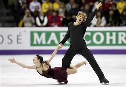 Meryl Davis and Charlie White of the U.S. perform their ice dance free dance at the ISU World Figure Skating Championships in London, Ontario, March 16, 2013. REUTERS/Mark Blinch