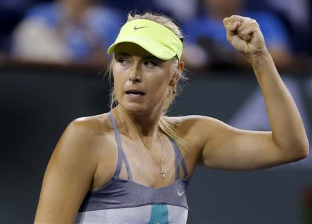 Maria Sharapova of Russia celebrates defeating compatriot Maria Kirilenko in their women's singles semifinal match at the BNP Paribas Open WTA tennis tournament in Indian Wells, California, March 15, 2013. REUTERS/Danny Moloshok