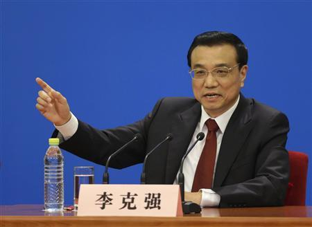 China's newly-elected Premier Li Keqiang gestures as he answers questions during a news conference after the closing session of the National People's Congress (NPC) at the Great Hall of the People in Beijing March 17, 2013. REUTERS/Jason Lee