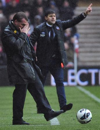 Liverpool's manager Brendan Rodgers (L) and Southampton's manager Mauricio Pochettino react during their English Premier League soccer match at St. Mary's stadium in Southampton in southern England March 16, 2013. REUTERS/Toby Melville