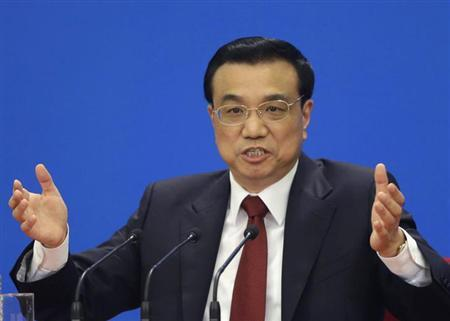China's newly elected Premier Li Keqiang gestures as he answers questions during a news conference after the closing session of the National People's Congress (NPC) at the Great Hall of the People in Beijing, March 17, 2013. REUTERS/Jason Lee