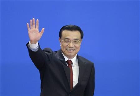 China's newly elected Premier Li Keqiang waves as he leaves a news conference after the closing session of the National People's Congress (NPC) at the Great Hall of the People in Beijing, March 17, 2013. REUTERS/Jason Lee