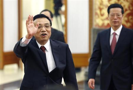 China's newly elected Premier Li Keqiang (front) waves as he and newly elected Vice-Premier Zhang Gaoli leave after the annual news conference following the closing session of the National People's Congress (NPC), at the Great Hall of the People in Beijing, March 17, 2013. REUTERS/Kim Kyung-Hoon