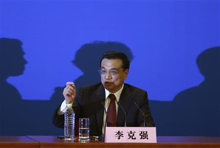China's newly-elected Premier Li Keqiang gestures as he answers a question during the annual news conference following the closing session of the National People's Congress (NPC), at the Great Hall of the People in Beijing, March 17, 2013. REUTERS/Kim Kyung-Hoon