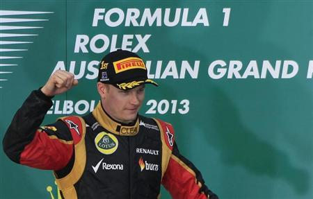 Lotus Formula One driver Kimi Raikkonen of Finland celebrates after winning the Australian F1 Grand Prix at the Albert Park circuit in Melbourne March 17, 2013. REUTERS/Scott Wensley