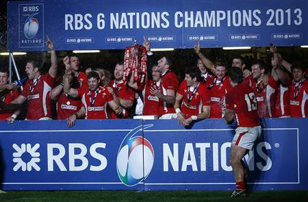 Wales' Gethin Jenkins (C) holds aloft the Six Nations Trophy after defeating England in their international rugby union match at the Millennium Stadium in Cardiff March 16, 2013. Wales won the Six Nations Championship. REUTERS/Eddie Keogh