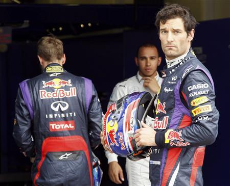 Red Bull Formula One driver Mark Webber of Australia looks on next to teammate Sebastian Vettel of Germany (L) as Mercedes Formula One driver Lewis Hamilton of Britain is seen, after the qualifying session of the Australian F1 Grand Prix at the Albert Park circuit in Melbourne March 17, 2013. REUTERS/Brandon Malone