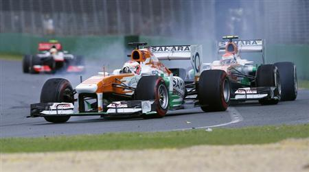 Force India Formula One driver Paul di Resta of Britain brakes in front of teammate Adrian Sutil of Germany during the Australian F1 Grand Prix at the Albert Park circuit in Melbourne March 17, 2013. REUTERS/Mark Horsburgh